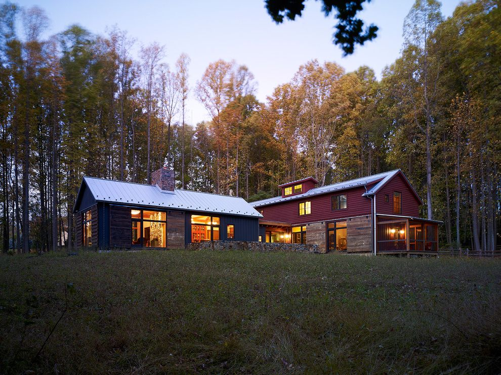 What is a Pole Barn   Rustic Exterior Also Barn Blue Barn Chimney Dormer Gable Roof Heavy Wood Panels Lawn Red Barn Window Shutters Wood Panelling