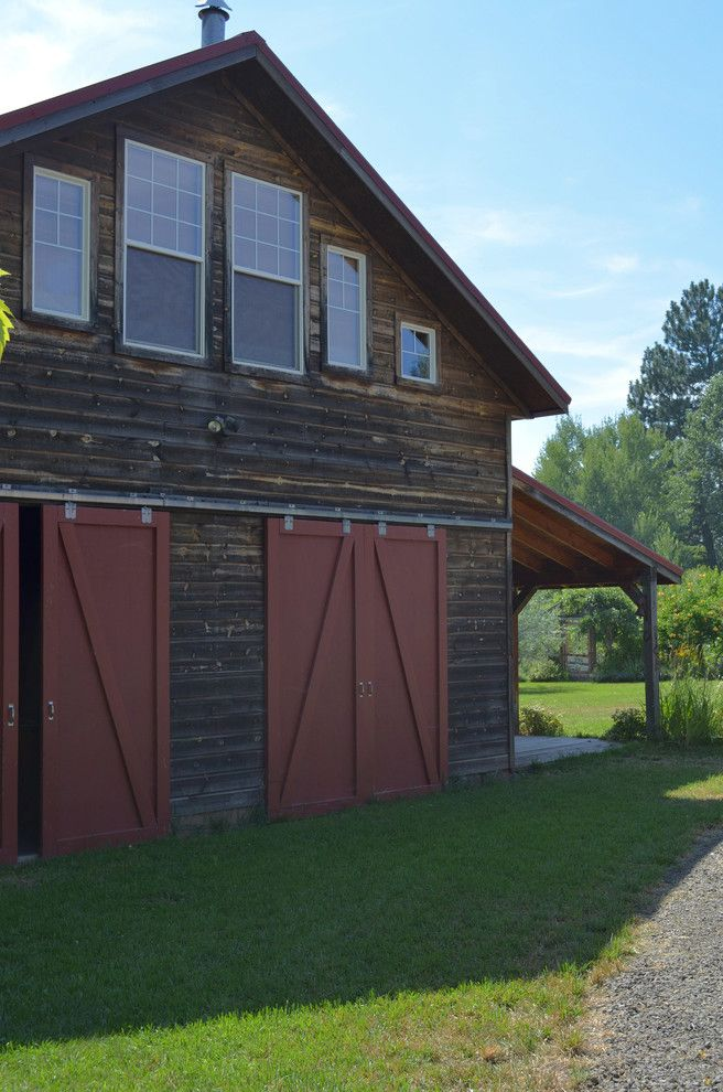 What is a Pole Barn   Rustic Exterior Also Barn Cabin Doors Driveway Gable Roof Grass Gravel Oregon Red Red Door Rustic Sliding Barn Door Upstairs Windows Wood Siding