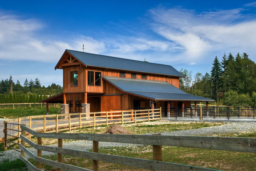 What is a Pole Barn with Farmhouse Shed Also Barn Barn Door Country Equestrian Fence Horse Barn Horses Lean to Metal Roof Ranch Rancher Roof Overhang Roof Truss Rustic Shed Split Rail Fence Stable Timber Wood Wood Fencing Wood Siding