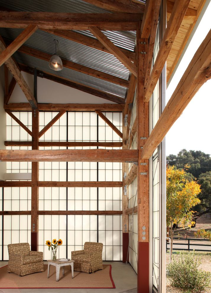 What is a Pole Barn with Industrial Shed Also Armchairs Barn Beams Industrial Jute Rug Sliding Door Sunflowers Timber Translucent Glass Truss Wall of Windows