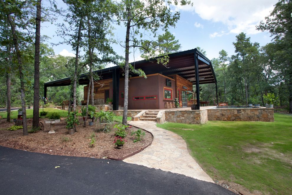 What is a Pole Barn with Rustic Exterior  and Canopy House Grove House with Canopy Steel Canopy Stone Wall Trees Wrap Around Porch