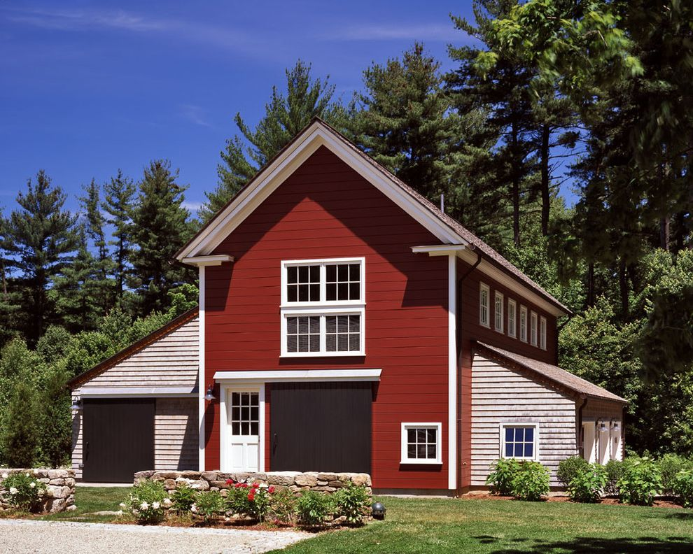 What is a Pole Barn with Traditional Shed  and Barn Large Brown Door Mixed Material Outdoor Lighting Red Barn Red Exterior Shingle Exterior Shingle Siding Shingle Style White Door White Trim White Windows