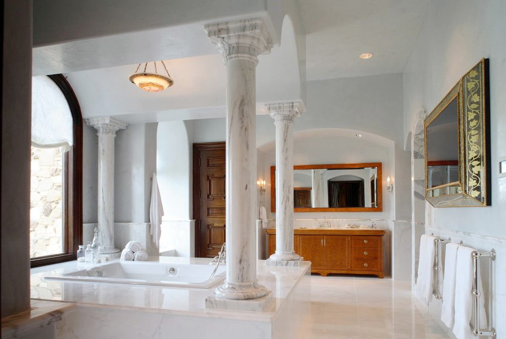 What is a Roman Tub   Traditional Bathroom  and Bathroom Mirror Bathroom Tv Bowl Chandelier Double Sinks Double Vanity Hidden Tv Marble Columns Marble Tub Surround Mirror Tv Neutral Colors Pendant Lighting Soaking Tub Towel Bars White Bathroom