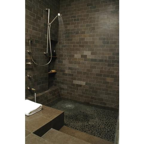 What is a Roman Tub with Modern Bathroom Also Bath Bath and Shower Brown Chrome Chrome Fixtures Dark Floor Tile River Rock Shower Shower Head Shower Tiles Stone Textures Tiles Tilework Towels