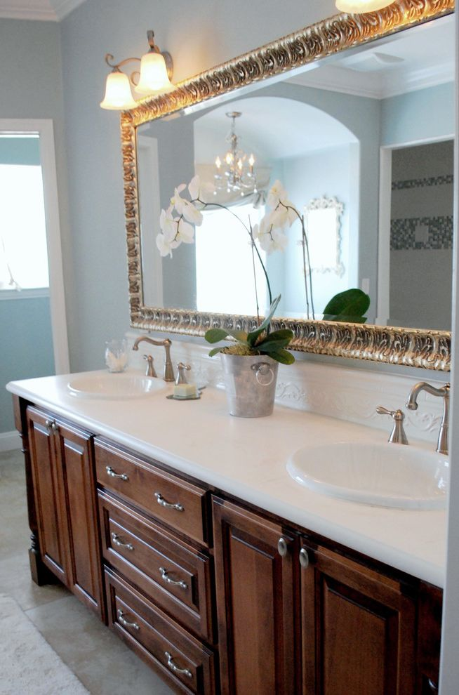 What is Cultured Marble with Traditional Bathroom  and Backsplash Brushed Nickel Double Sink Double Vanity Frame Gold Frame Light Blue Moulding Orchid White Counter Wood Vanity