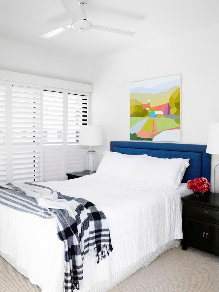 What is He Detergent   Transitional Bedroom  and Apartment Bed Head Bedroom Bedside Table Black and White Throw Blue Headboard Ceiling Fan Colorfuul Art Lamps White Shutters