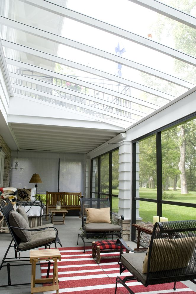 What is Polycarbonate with Traditional Sunroom  and Area Rug Enclosed Porch Outdoor Cushions Patio Furniture Skylights Sunroom Wood Siding Wrought Iron Furniture
