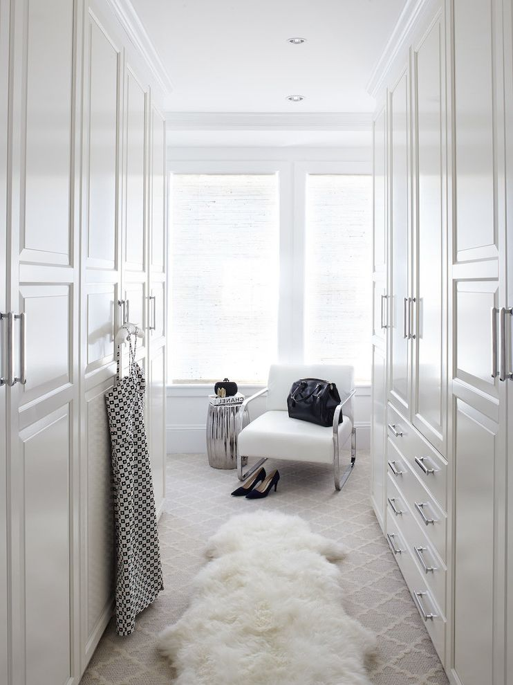 What is Polypropylene   Transitional Closet  and Bar Pulls Roman Shade Sheep Skin Rug White Chair