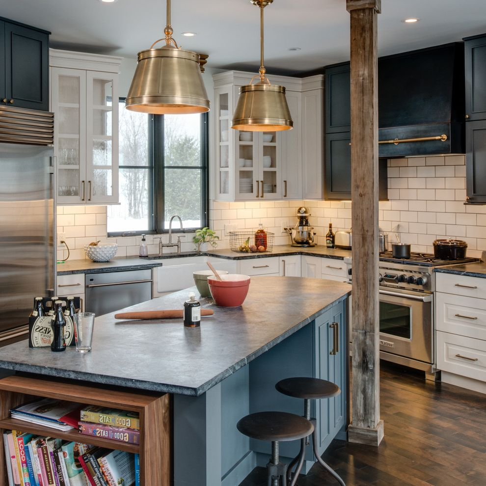 What is Soapstone   Contemporary Kitchen Also Black and White Cabinets Bookshevles Cookbook Storage Dark Wood Flor Gold Pendant Lights Good Eats Metal Bar Stools Metal Pendant Lights Mixing Bowls Round Bar Stools Swivel Bar Stools