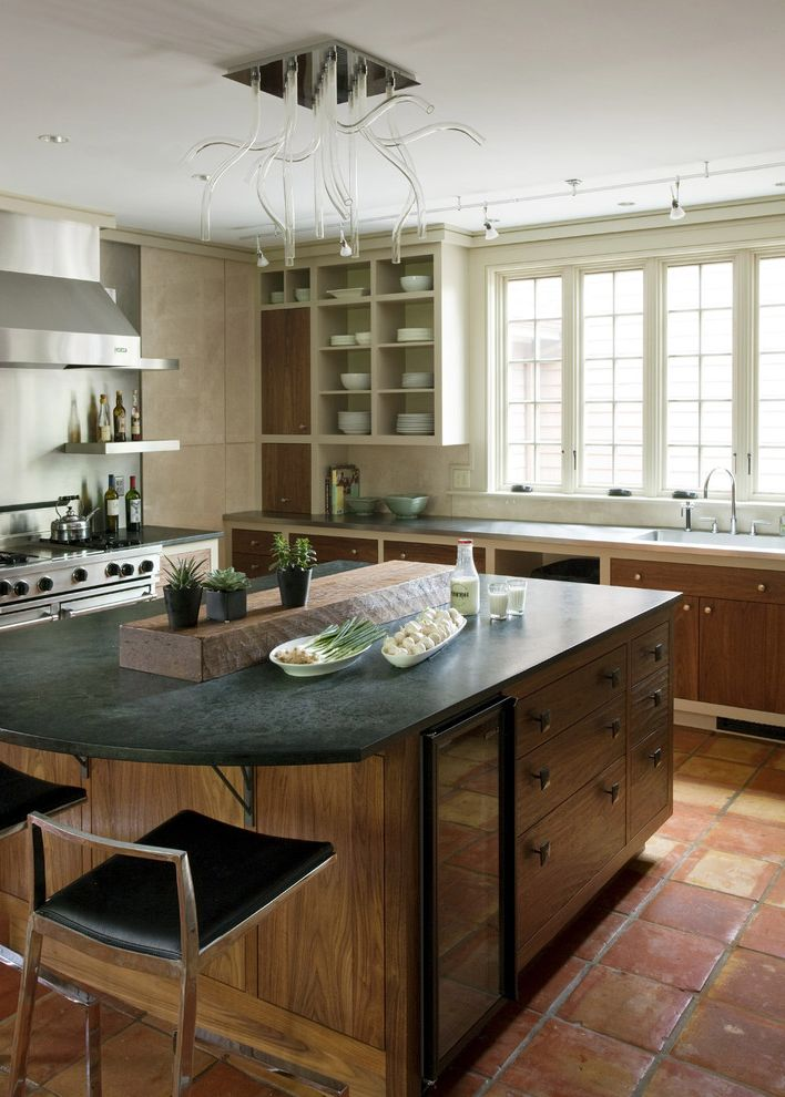 What is Soapstone   Rustic Kitchen Also Breakfast Bar Ceiling Lighting Eat in Kitchen Kitchen Hardware Kitchen Island Kitchen Shelves Modern Light Fixture Open Shelves Terracotta Floor Tile Tube Lights Two Tone Cabinets Wine Refrigerator