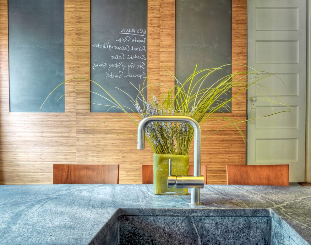 What is Soapstone with Contemporary Kitchen  and Breakfast Bar Chalkboard Chalkboard Walls Eat in Kitchen Floral Arrangement Integrated Soapstone Sink Modern Faucet Paneling Wood Barstools