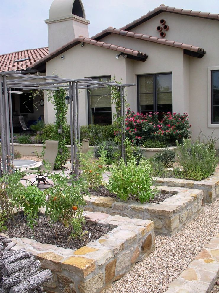 What is Square Foot Gardening with Mediterranean Landscape and Arbor Edible Garden Gravel Path Growing Trellis Raised Beds Seat Wall Stone Planters Tomatoes Trellis Vegetable Garden