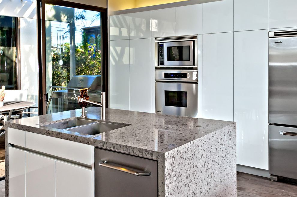 What is the Effect of Oven Cleaner on Kitchen Countertops with Modern Kitchen  and Compact Kitchen Glass Slider Gray Gray Stained Wood Floor Island Patio Small Kitchen Stainless Steel Appliances White White High Gloss Cabinets