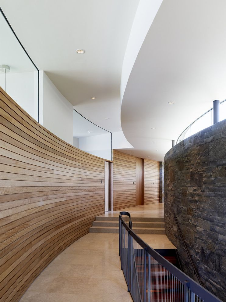 Which Way is Horizontal   Modern Hall  and Glass Iron Railing Marble Marble Floor Recessed Lighting Slatted Wood Wall Sliding Door Steps Stone Wall Wood Wall