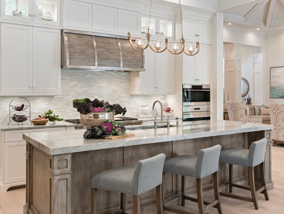 Which Way to Lay Wood Floor   Transitional Kitchen Also Bright Kitchen Gray Matchstick Tile Gray Upholstered Barstools Light Brown Accents Pendant Light
