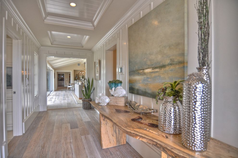 Which Way to Lay Wood Floor with Beach Style Hall  and Baseboards Board and Batten Ceiling Treatment Console Table Crown Molding Live Edge Wood Tablescape Vase Vignette Wall Art Wall Decor White Wood Wood Flooring Wood Paneling Wood Slab Wood Trim