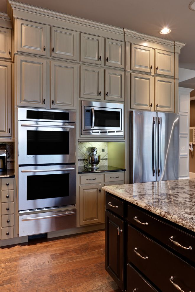 Whirlpool Otr Microwave   Traditional Kitchen  and Ceiling Lighting Crown Molding Kitchen Hardware Kitchen Island Recessed Lighting Stainless Steel Appliances Two Tone Cabinets Wood Cabinets Wood Flooring Wood Molding