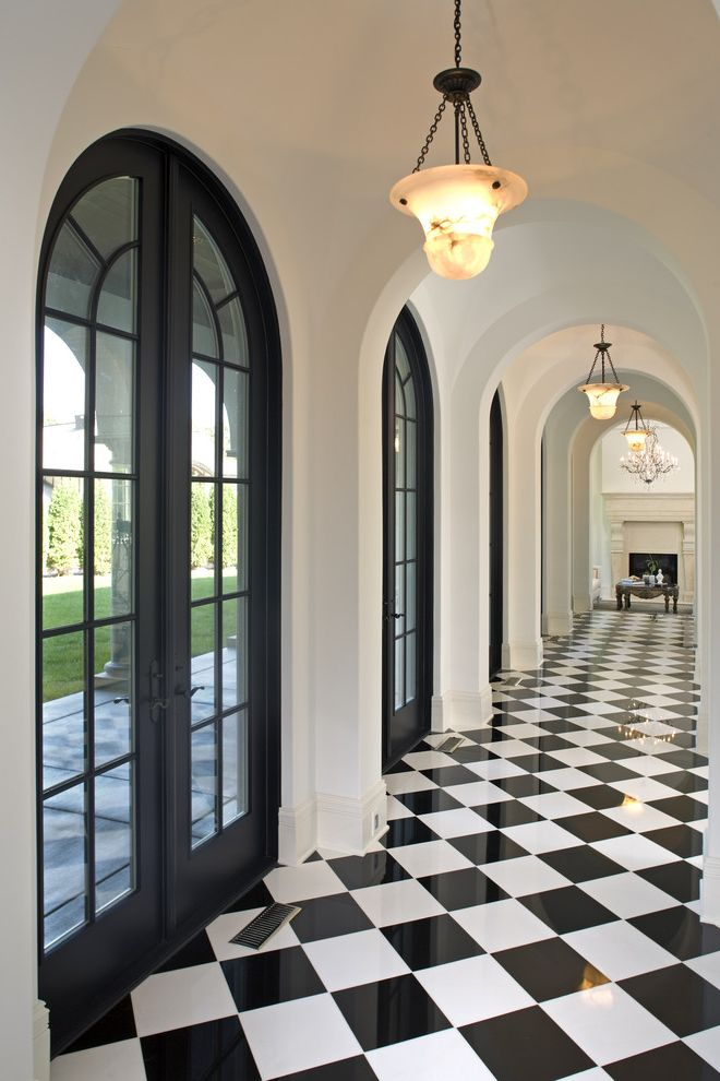 White Eagle Septic   Mediterranean Hall Also Archway Bell Pendant Lighting Black and White Black and White Floor Pattern French Doors Harlequin Floor Pattern Neutral Colors Patio Doors Vaulted Ceiling