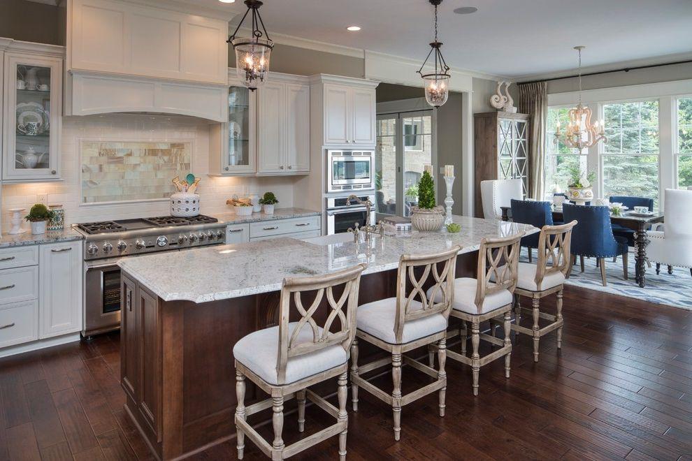 White Eagle Septic   Traditional Kitchen  and Backsplash Tile Detail Bar Seating Glass Pendant Lights Island Seating Light Wood Bar Stools White Countertop