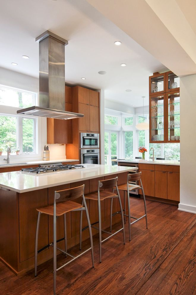 White Knight Pest Control   Contemporary Kitchen Also Glass Front Cabinets High Ceiling Quartz Countertop Recessed Lighting Two Sided Cabinet White Countertop Wood Bar Stools