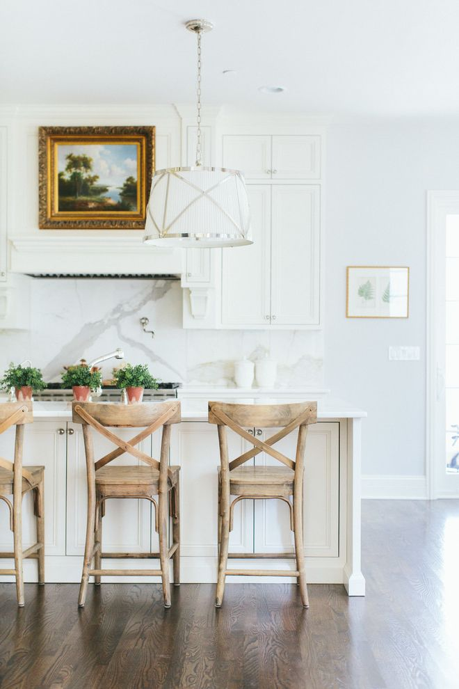 White Leather Bar Chairs   Transitional Kitchen Also Gold Framed Art Gray Walls Indoor Plants Madeleine Chair Marble Backsplash White Cabinets White Ceramic Jars White Kitchen Wood Chair Wood Floors