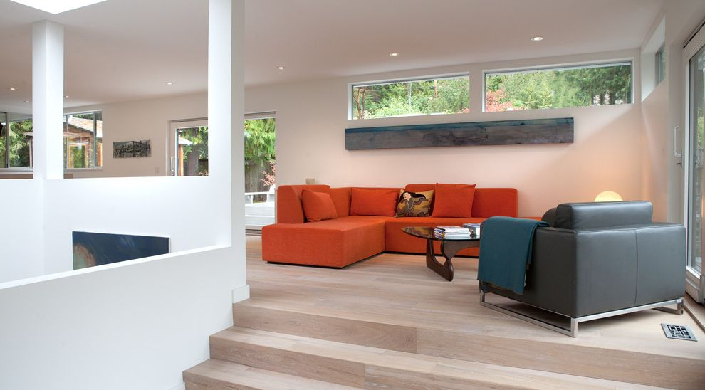 White Wash Wood Floors   Modern Living Room Also Artwork Clerestory Windows Gray Open Space Orange Sofa Patio Doors Recessed Lights Sky Lights Sliding Windows Steps White Oak Floor White Walls