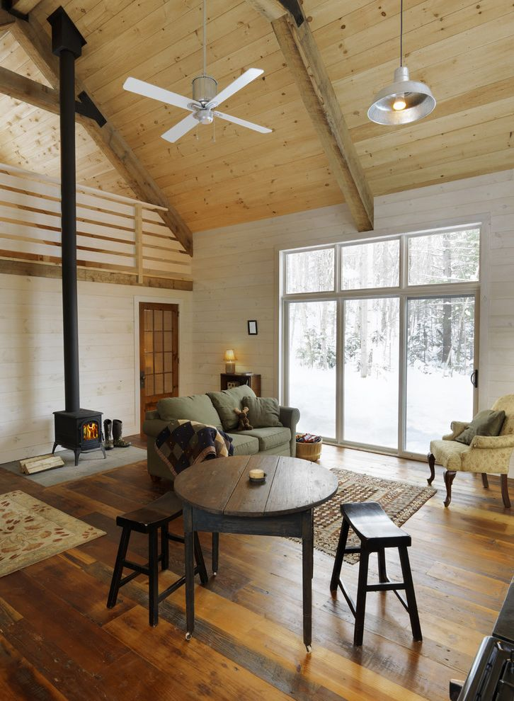 White Wash Wood Floors   Rustic Living Room Also Barn Lamp Cabin Ceiling Fan Double Height Fireplace Loft Rustic Rustic Wood Floor Sloped Ceiling Sofa Stool Vaulted Ceiling White Paint Wood Ceiling Wood Floor Wood Table Wood Wall Wood Burning Stove