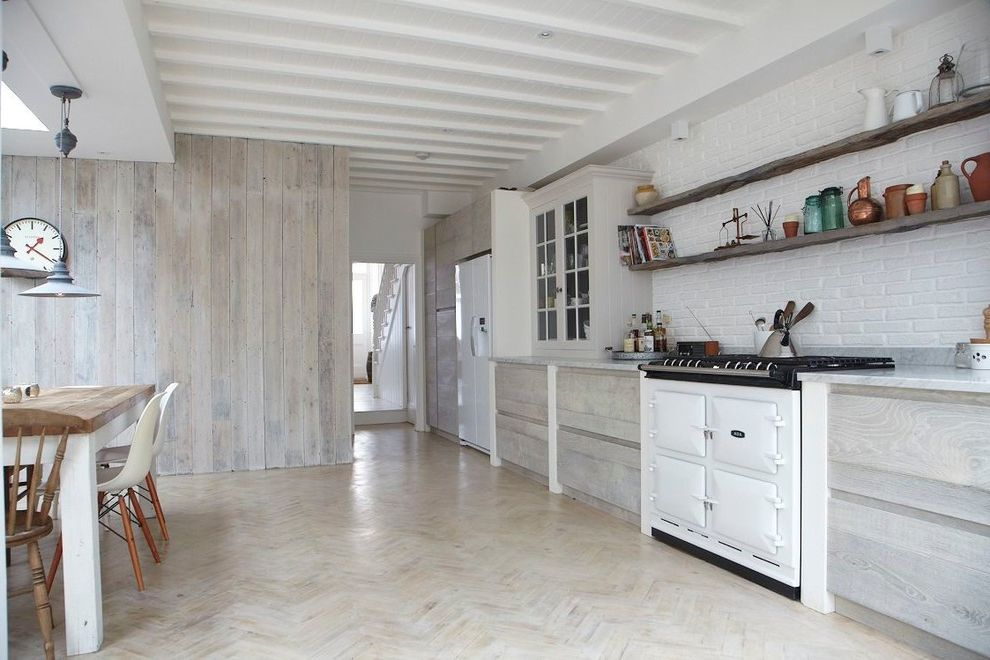 White Wash Wood Floors   Scandinavian Kitchen Also Aga Eames Molded Plastic Chair Parquet Flooring Wall Clock White Beadboard Ceiling White Painted Brick Wall White Washed Wood Stain White Wood Ceiling Beams Wooden Floating Shelves