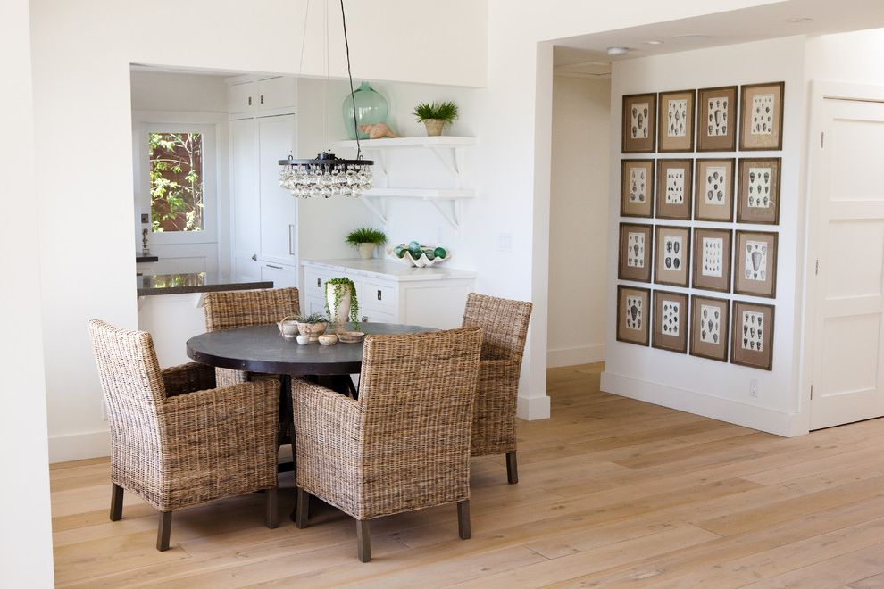 White Wash Wood Floors with Contemporary Dining Room  and Artwork Baseboards Cottage Country French Oak Open Shelves Pedestal Dining Table Round Dining Table Vintage Floors Wall Art Wall Decor Wicker Dining Chairs Wide Plank Wood Floor Wood Flooring