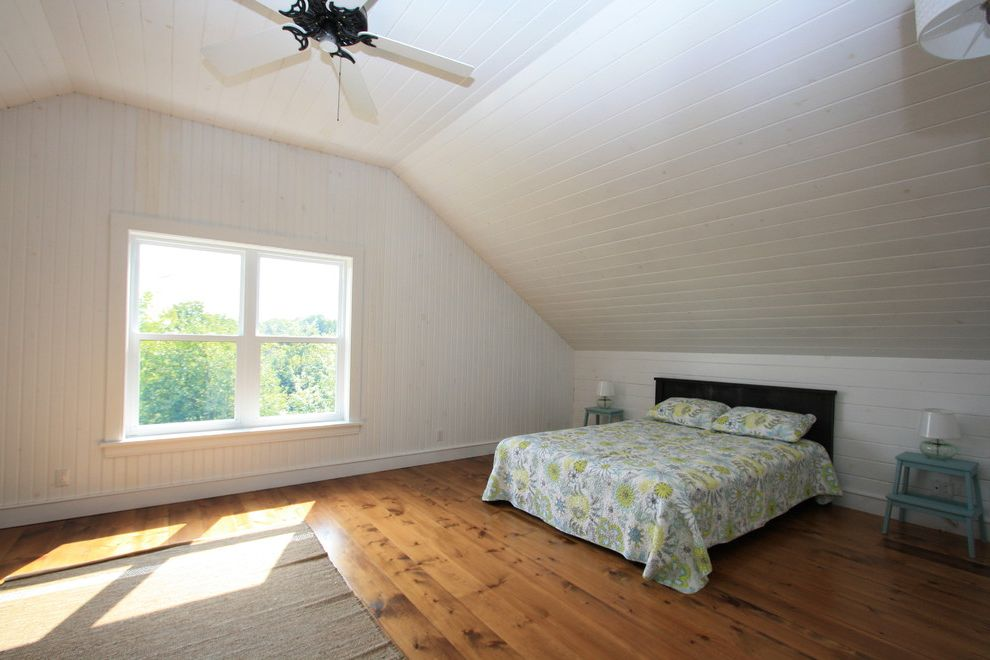 Whites Lumber   Beach Style Bedroom  and Bedroom Bright Clean Coastal Cottage Country Open Concept Pine Plank Flooring Rustic Tongue and Groove Ceiling White White Painted Wood White Trim Wood for Walls