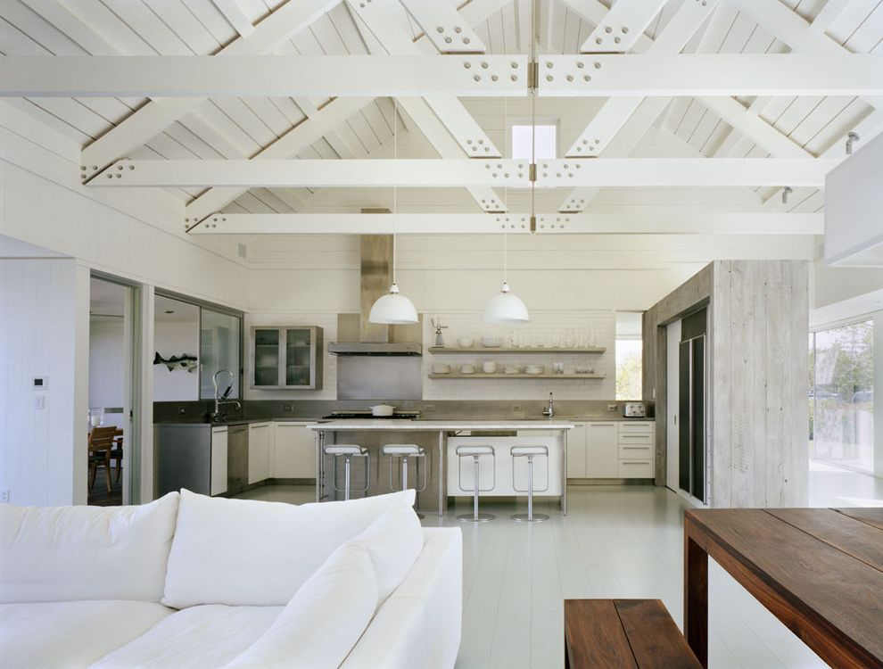 Whites Lumber   Beach Style Kitchen Also Barn Breakfast Bar Eat in Kitchen European Exposed Beams Great Room Monochromatic Neutral Colors Open Floor Plan Open Kitchen Rustic Sloped Ceiling Vaulted Ceiling White White Floor White Kitchen Wood Flooring