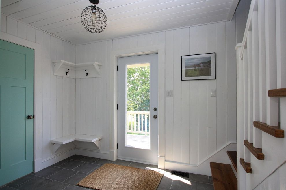 Whites Lumber   Rustic Entry  and Bright Built in Bench Seat Clean Coastal Coat Hooks Corner Shelf Cottage Country Lake House Open Concept Painted Walls and Ceiling Rustic Staircase White Wood