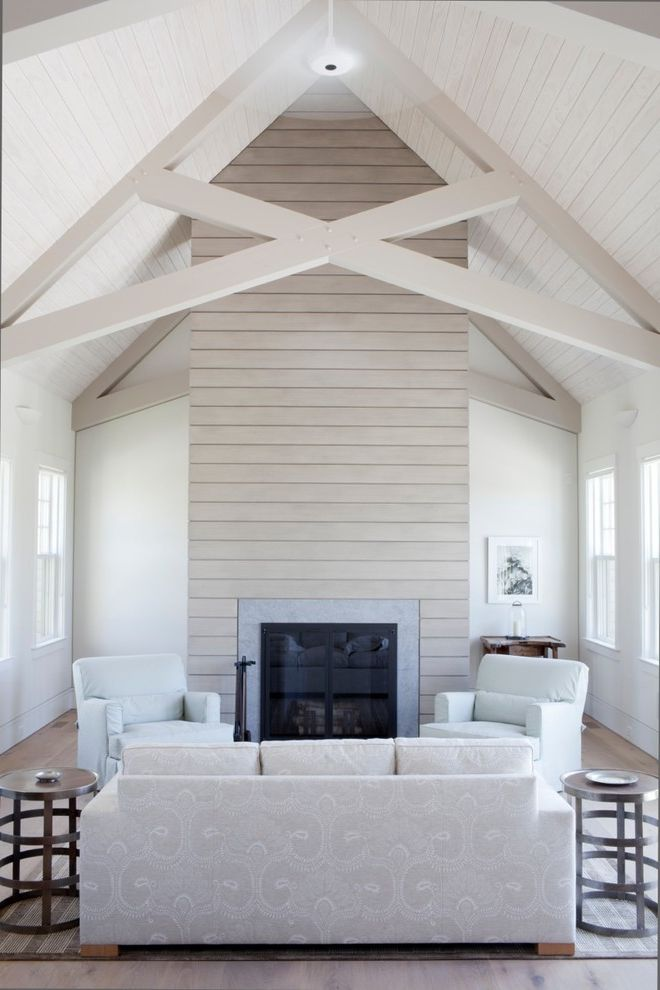 Whites Lumber with Transitional Living Room Also Exposed Beams Fireplace No Curtains Tongue and Groove Ceiling Vaulted Ceiling White Chairs White Couch White Room