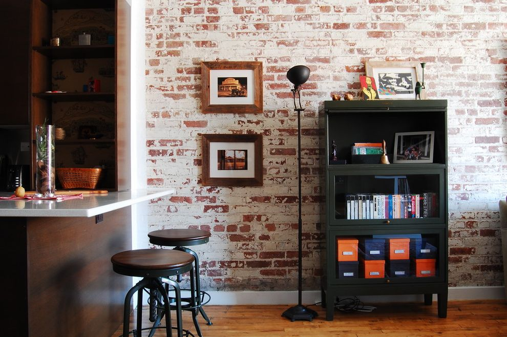 Whitewash Bookcase with Industrial Kitchen Also Black Bookcase Black Floor Lamp Breakfast Nook Exposed Brick Wall Floor Lamp Hardwood Floor Icestone Industrial Lawyers Case Open Shelves Round Bar Stools Toledo Stools