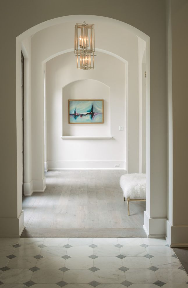 Whitewash Hardwood Floors with Transitional Hall  and Arched Doorways Arched Hallway Archways Diamond Floors Fur Stool Natural Lighting