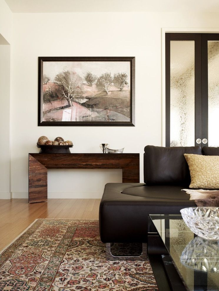 Whitewashed Console Table   Contemporary Living Room Also Area Rug Artwork Console Table Global Leather Sofa Neutral Colors Oriental Rug Pocket Doors Wall Art Wall Decor