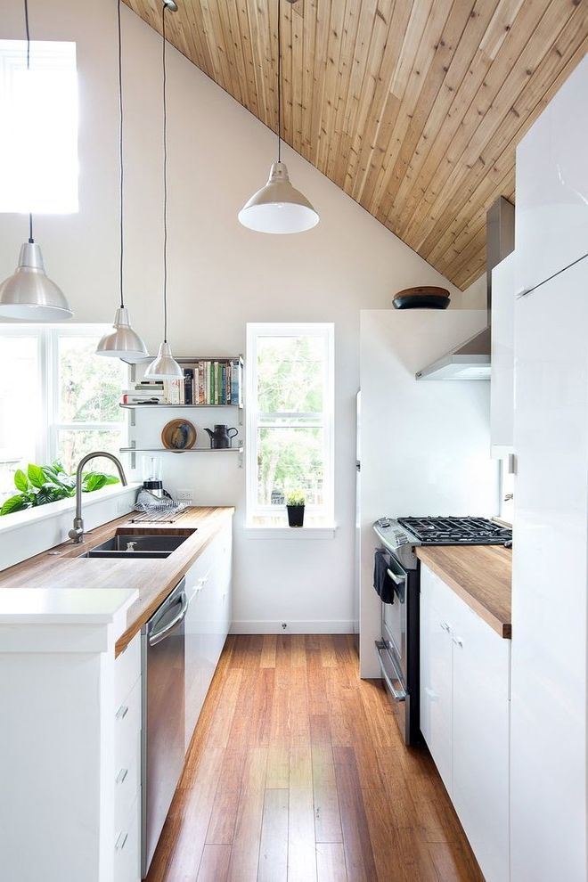 Who Makes Kenmore Dishwashers   Scandinavian Kitchen  and Chrome Pendants Cookbooks Kitchen Appliances Narrow Kitchen Range Cooker Sloped Ceiling Stainless Steel Pendants White Kitchen White Walls Wood Panel Ceiling Wooden Worktops