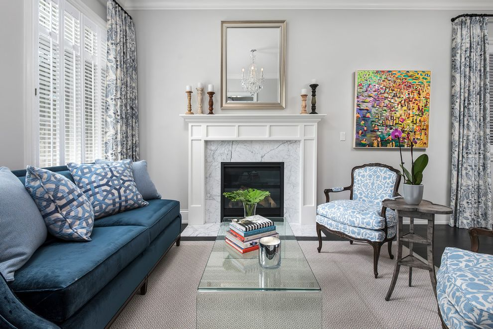 Wickmans Furniture with Transitional Living Room Also Beige Area Rug Blue and White Armchair Blue Sofa Glass Coffee Table Mirror Above Fireplace Shutters Wall Art