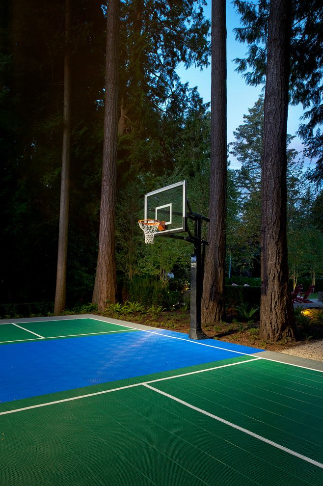 Width of a Basketball Court with Traditional Landscape  and Basketball Court Blue Forest Gravel Path Green Hoop Landscape Lights Mature Trees Outdoor Basketball Court Red Adirondack Chairs Shady Woods