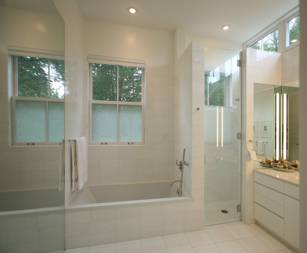 Window Film Lowes   Transitional Bathroom  and Clean Lines Flush Cabinets Glass Shower Door Mirror Recessed Lights Shower Enclosure Soaking Tub Specialty Glass Tile Floor Transom Windows White High Gloss White Walls
