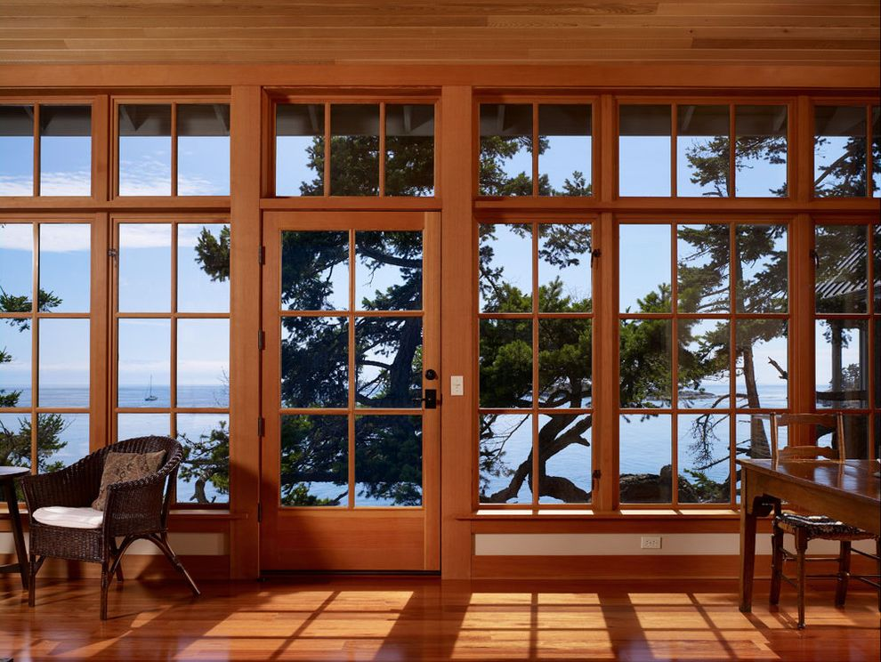 Window Film Lowes with Beach Style Living Room  and Armchair Coastal Glass Doors Glass Wall Ocean View Patio Door Sunroom View Waterfront Wicker Furniture Wood Ceiling Wood Flooring