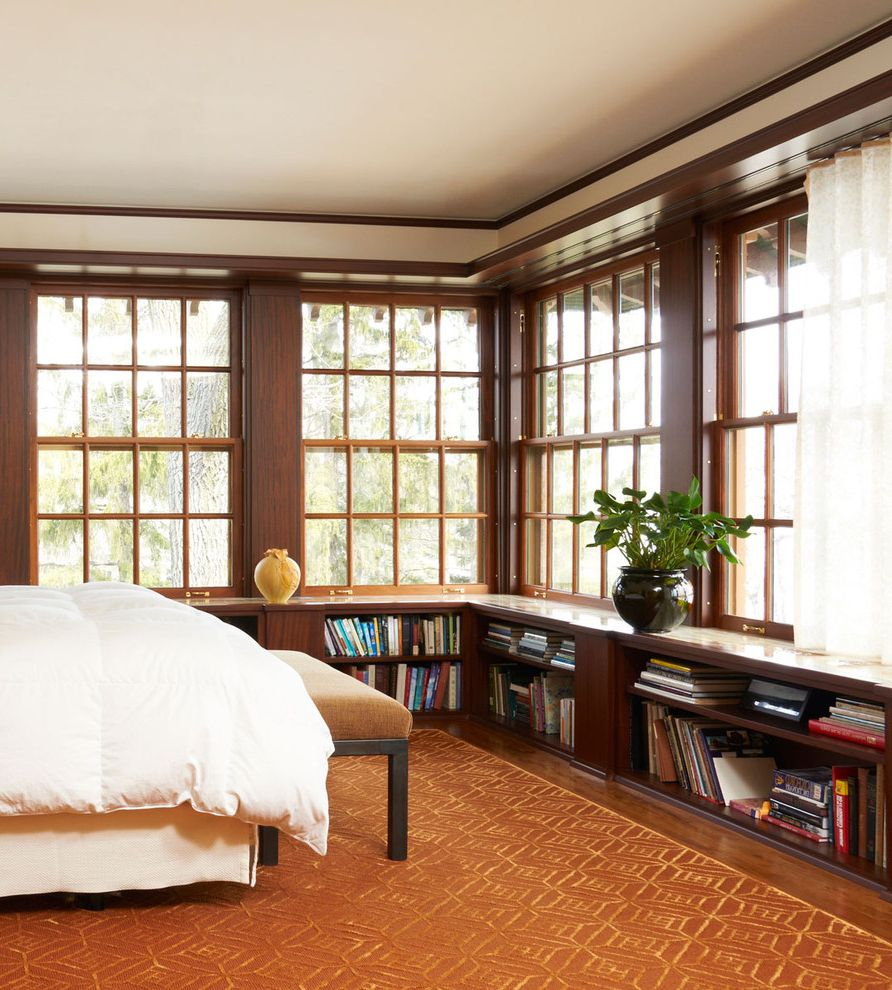 Window Film Lowes with Traditional Bedroom  and Bedroom Bench Dark Wood Bookcase Dark Wood Bookshelf Dark Wood Column Dark Wood Pillar Dark Wood Window Trim Low Bookcase Orange Area Rug Patterned Rug Sheer Curtain White Bedding Window Wall