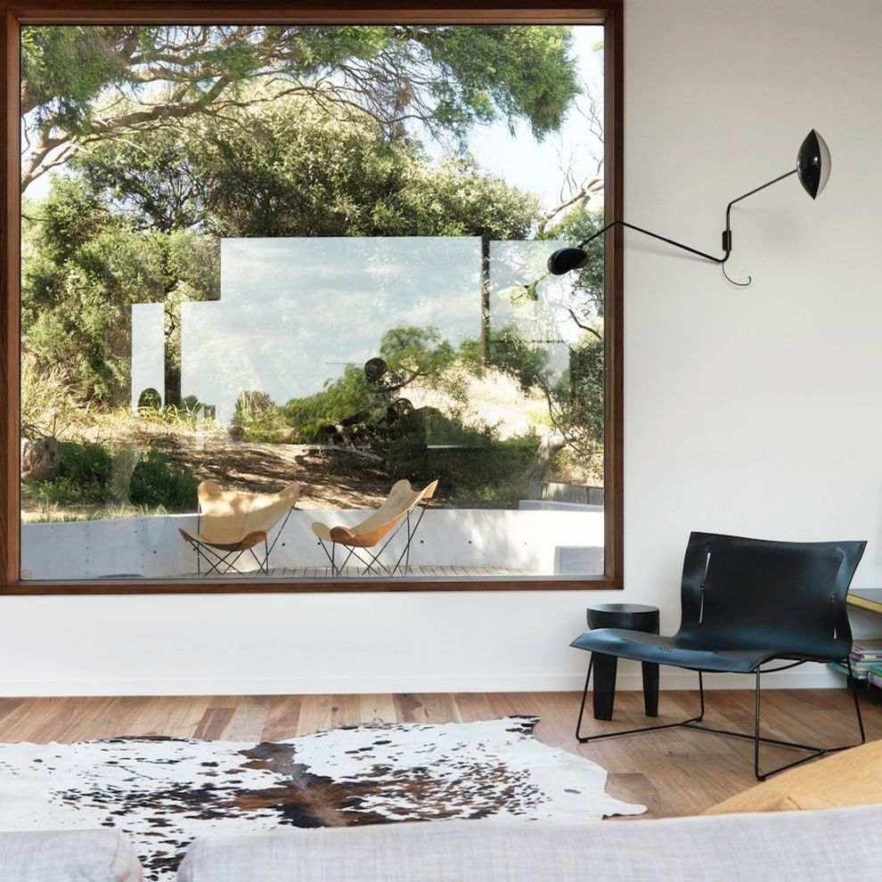 Window Replacement Fort Worth with Contemporary Living Room Also Animal Skin Rug Butterfly Chair Butterfly Chairs Cowhide Rug Double Arm Wall Light Leather Chair Living Room Picture Window Swing Arm Wall Light Timber Floor Timber Window