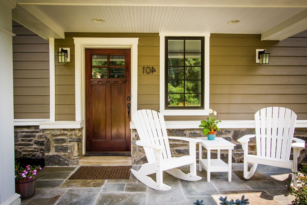 Window Tinting Fort Wayne   Traditional Porch  and Adirondack Rocking Chair Beige Exterior Beige Siding Covered Porch House Number Stone Exterior Stone Floor Stone Siding Wall Sconce White Adirondack Chair White Side Table Wood Front Door