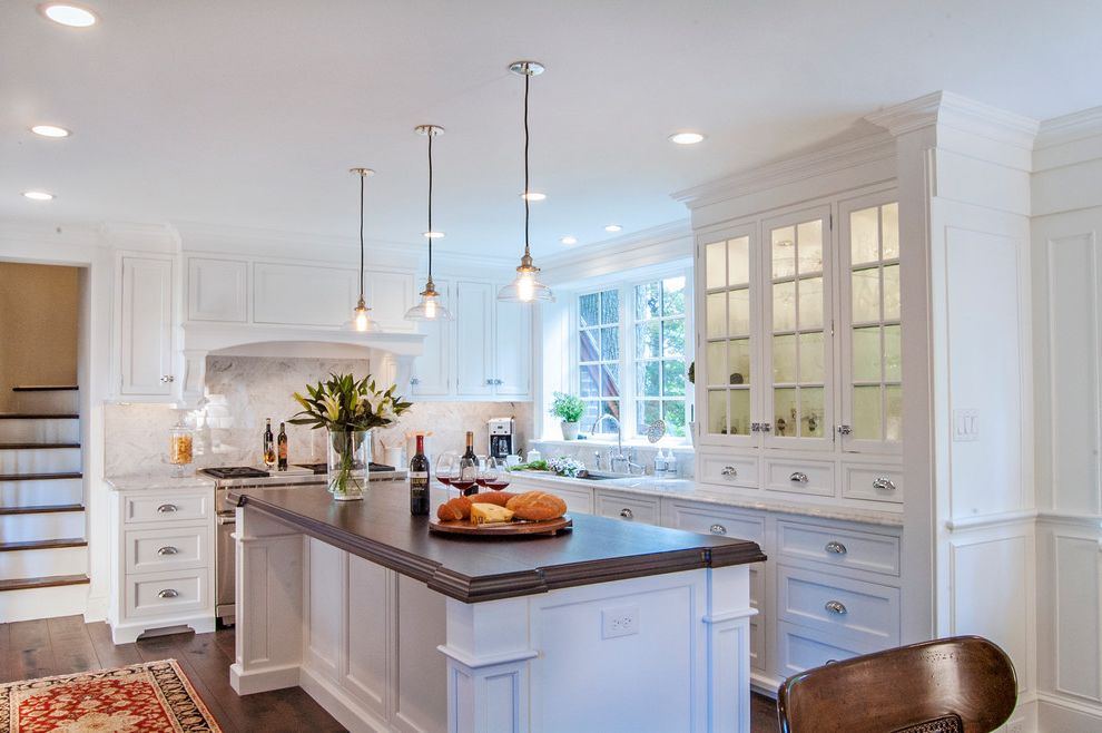 Window Tinting Fort Wayne with Traditional Kitchen Also Dark Wood Countertop Glass Front Cabinets Glass Pendant Light Recessed Lighting White Countertop Wood Island Counter