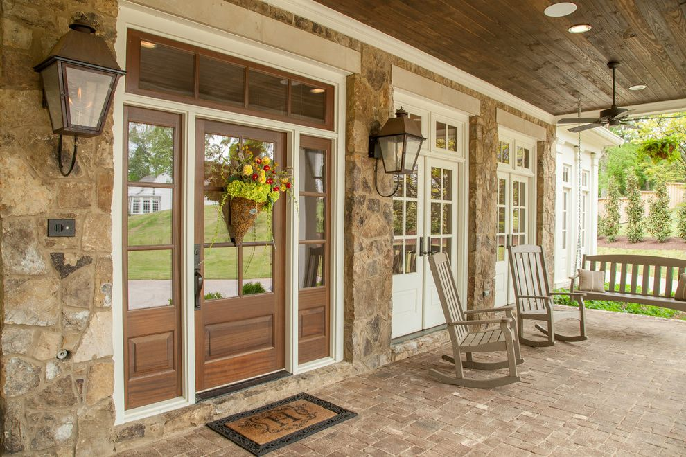 Window Tinting Fort Wayne with Traditional Porch  and Brick Exterior Gray Hardwood Flooring Limestone Rustic Wood Stones Traditional Design White Painted Wood