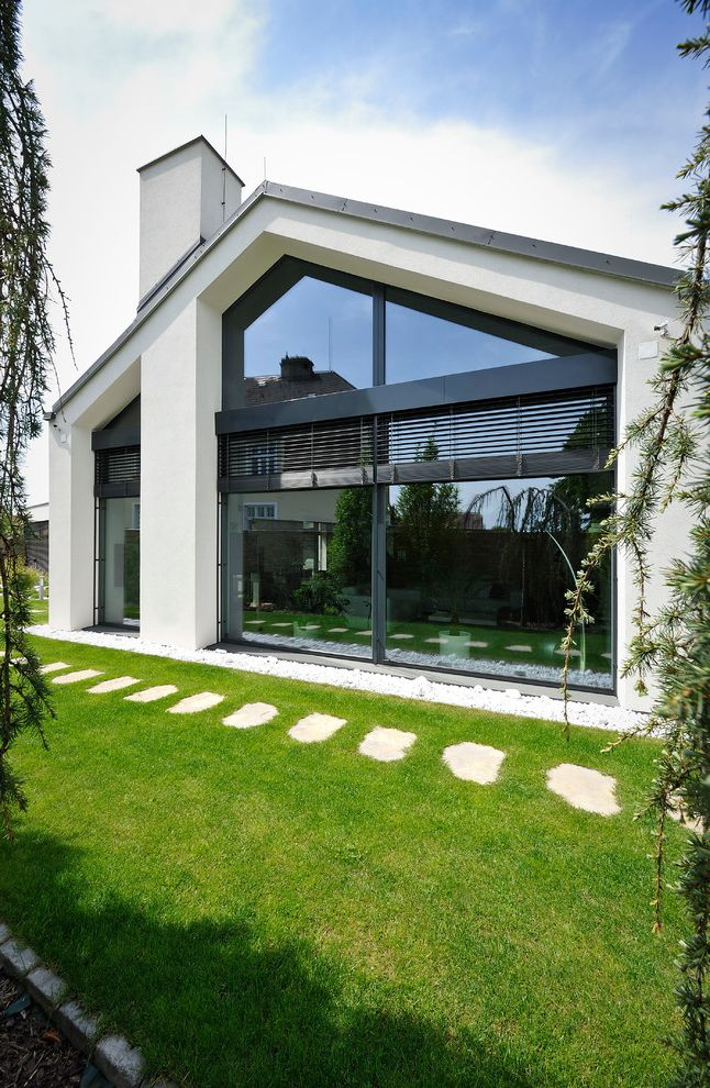 Windows with Built in Blinds   Contemporary Exterior Also Backyard Chimney Edging Floor to Ceiling Windows Gable Roof Grass Lawn Metal Slats Open Landscaping Path Pavers Picture Windows Steel Frame Windows Stones Sunlight Walkway