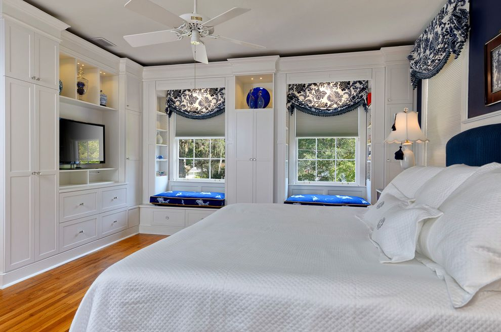 Windows with Built in Blinds   Traditional Bedroom Also Asian Flare Blue and White Built in Cabinets Ceiling Fan Custom Cabinetry Custom Storage Historic Home Traditional Valence Waiscotting White Coverlet Window Seat Window Seats Window Treatments