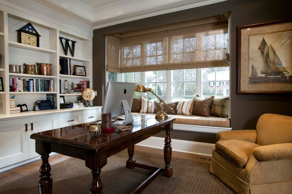 Windows with Built in Blinds   Traditional Home Office  and Area Rug Armchair Bookshelves Built in Bench Built in Cabinetry Dark Brown Wall Desk Lamp Framed Wall Art Hardwood Floor Neutral Colors Seat Cushions Window Wood Desk Woven Shades