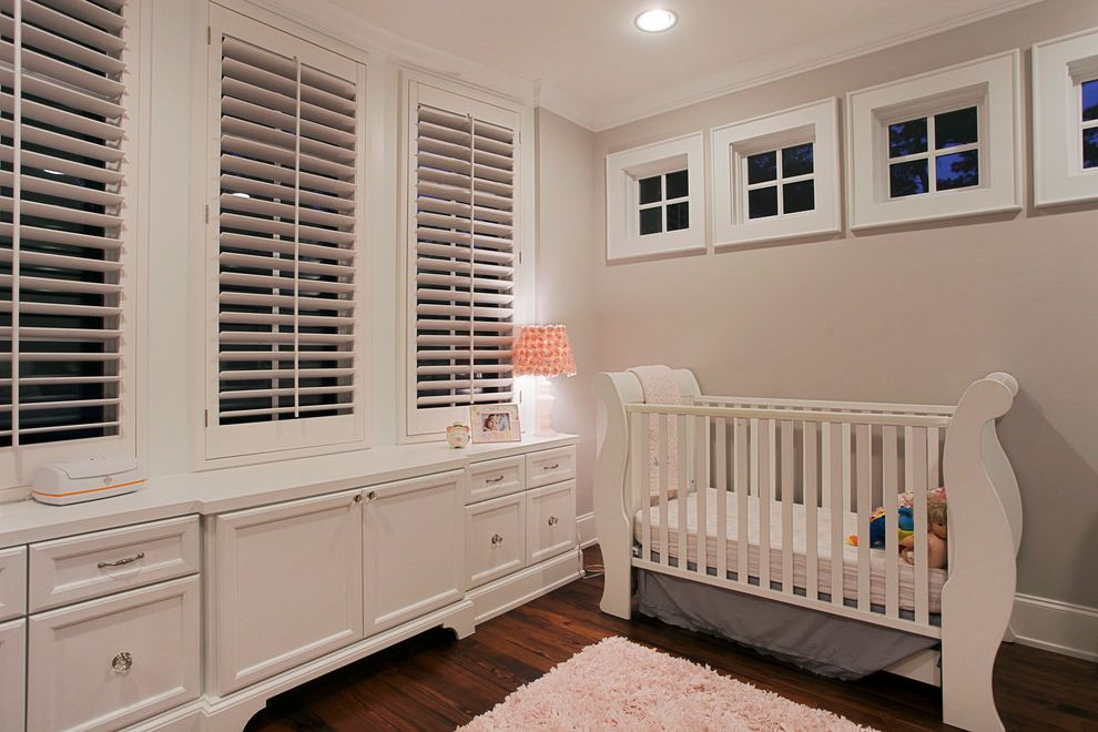 Windows with Built in Blinds with Traditional Nursery Also Babys Room Dark Wood Floor Gender Neutral Nursery Girls Room Kids Lamp Nursery Pink Rug Plantation Shutters Shag Rug Square Windows White Cabinets White Crib White Drawers White Shutters